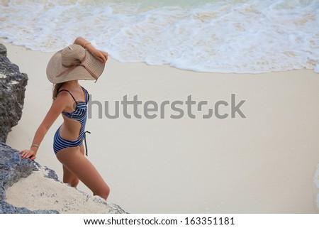 woman enjoying a day at the Caribbean beach - stock photo