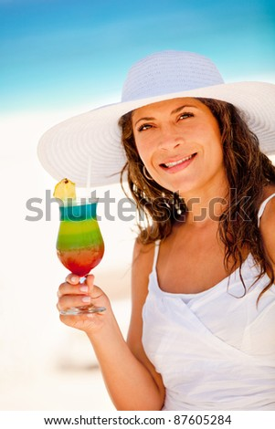 Woman enjoying a drink on her holidays at the Caribbean - stock photo