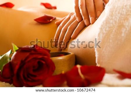 Woman enjoying a massage in a spa setting - stock photo