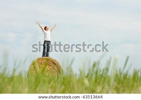 woman enjoying a nice warm autumnal day - stock photo