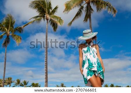 Woman, enjoying beach getaway - Hawaiian beach vacation. Enjoying every minute of this vacation. Summer in Waikiki beach, Honolulu city, Oahu, Hawaii, USA. - stock photo