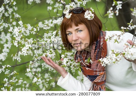 Woman enjoying cherry blossoms by springtime