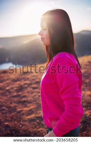 Woman enjoying freedom and life on beautiful and magical sunset. relaxed and happy.  - stock photo