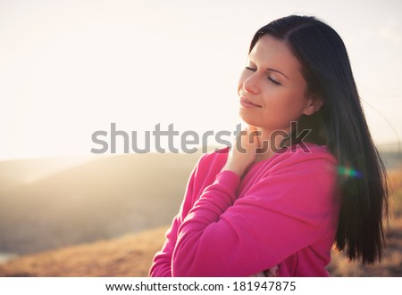 Woman enjoying freedom and life on beautiful and magical sunset. relaxed and happy. Photo toned style instagram filters - stock photo