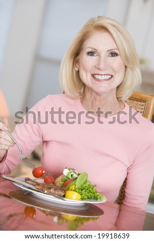 Woman Enjoying Healthy meal,mealtime - stock photo