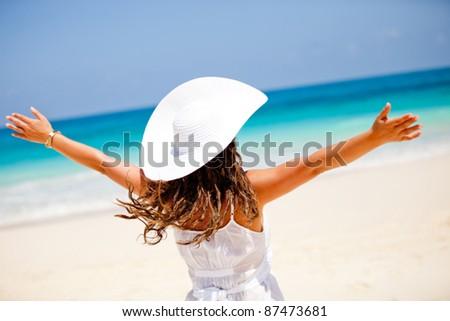 Woman enjoying her summer holidays at paradise - stock photo