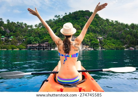 Woman enjoying her tropical vacation getaway.   - stock photo