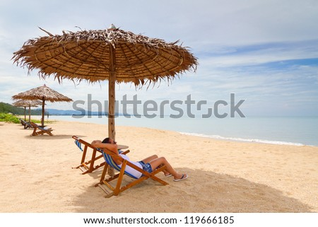 Woman enjoying holidays under parasol at Andaman Sea