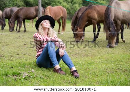 Woman enjoying horses company - stock photo