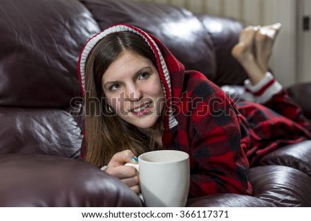 Woman Enjoying Hot Chocolate on Couch - stock photo