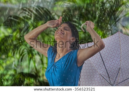 Woman enjoying in the rain
