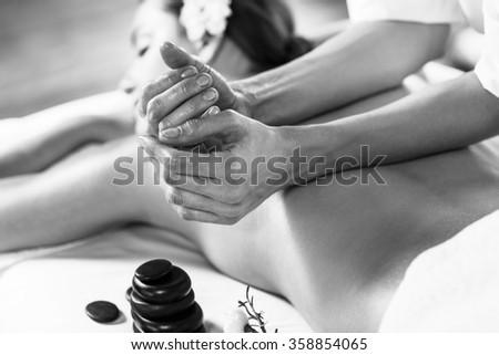 Woman enjoying massage. - stock photo