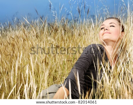 Woman enjoying on the wheat field, nature at autumn, natural landscape background, female outdoor - stock photo