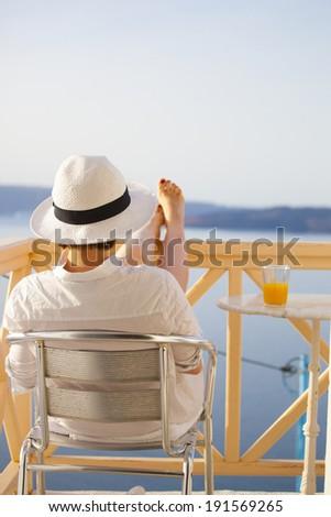 Woman enjoying sun on the tropic island - stock photo