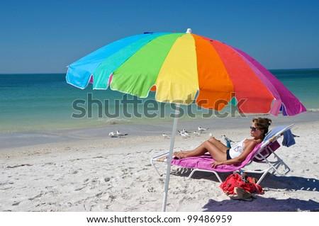 Woman Enjoying The Beach - stock photo