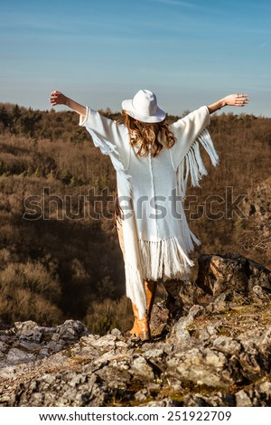 Woman enjoying the feeling of freedom walking in the mountains - stock photo