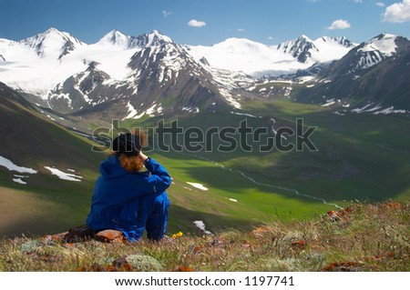 Woman enjoying the mountain view 2 - stock photo