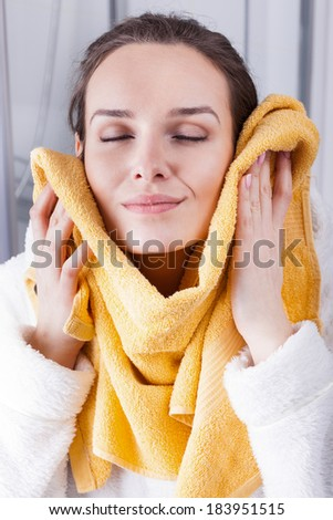 Woman enjoying the softness of a towel - stock photo