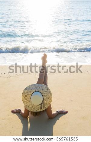 Woman enjoying the sun at the tropical beach - stock photo