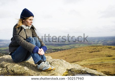 Woman Enjoying The Top Of A Mountain