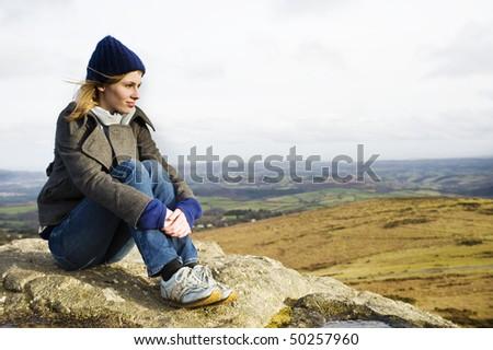 Woman Enjoying The Top Of A Mountain - stock photo