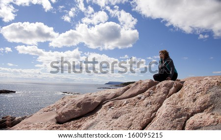 woman enjoying view beside the ocean