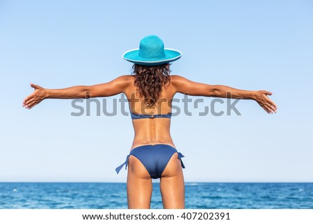Woman enjoying warm summer day at the seaside. - stock photo