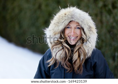 Woman Enjoying Winter - stock photo
