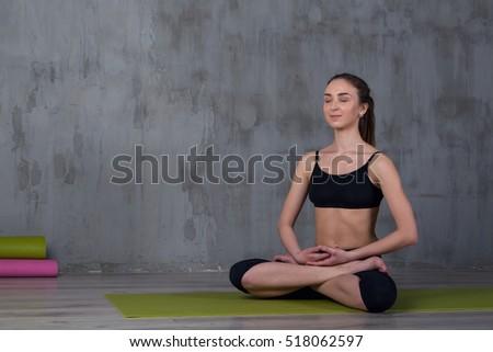 woman enjoying yoga indoors sitting lotus stock photo royalty free