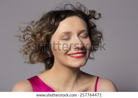 woman enjoys. nice smile on her face - stock photo