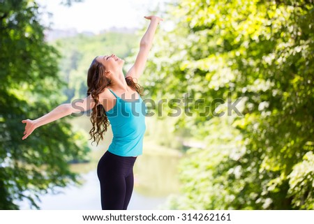 Woman enjoys the outdoors. - stock photo