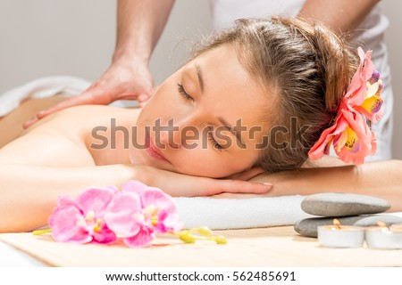 woman enjoys the spa cabinet during the massage