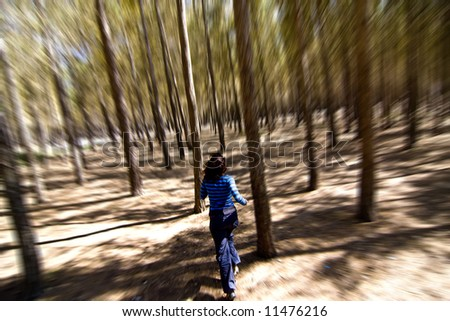 Woman escaping from unrevealed danger through the woods