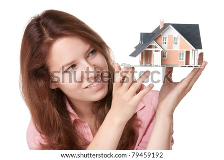 Woman (estate agency client) dream about new house - model of the house