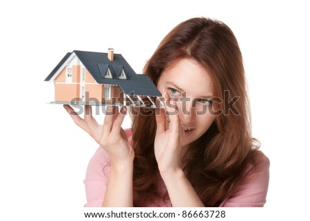 Woman (estate agency client or architect) browse new house represented by model - stock photo