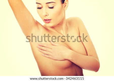 Woman examining breast mastopathy or cancer. - stock photo