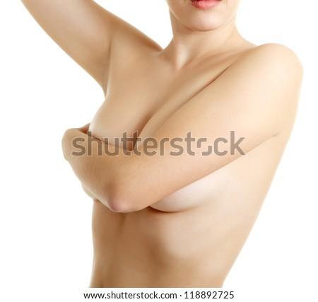 woman examining breast mastopathy or cancer isolated - stock photo