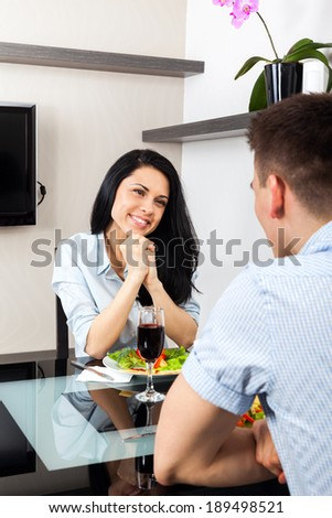 woman excited smile romantic dinner at restaurant, couple love sitting at table home - stock photo