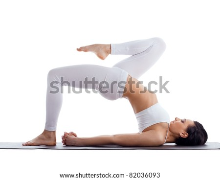woman exercise bend yoga pose on rubber mat - stock photo