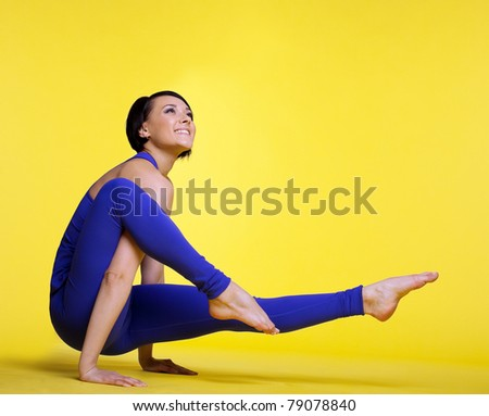 woman exercise yoga pose and smile - stock photo