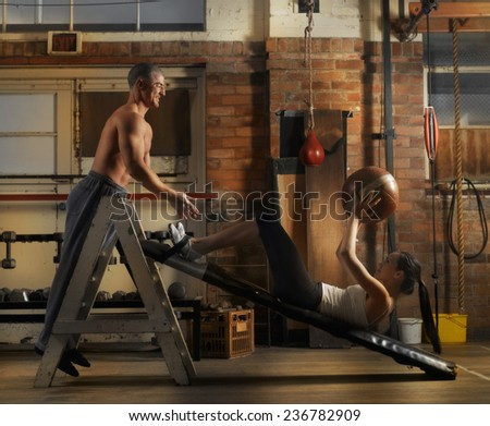 Woman Exercising at Gym - stock photo