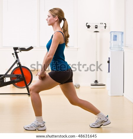 Woman exercising in health club - stock photo