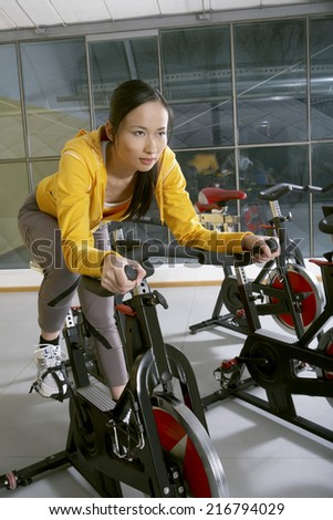 Woman exercising in the gym. - stock photo