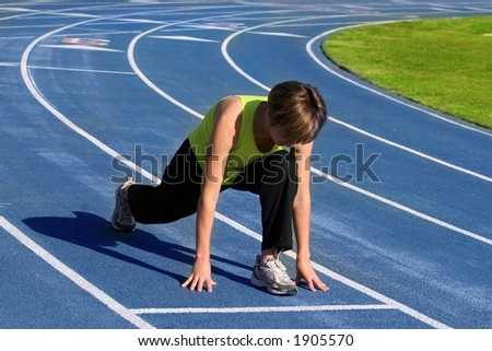 Woman exercising on a blue racetrack - stock photo