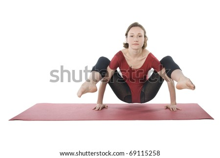 Woman exercising on a mat over white background