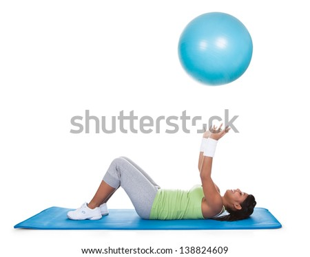 Woman Exercising On Pilates Ball Over White Background