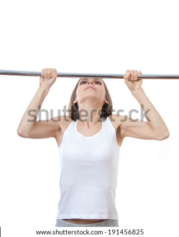 woman exercising on pull-up bar , isolated on white background - stock photo