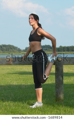 woman exercising outdoor - stock photo