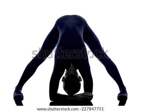 woman exercising Prasarita Padottanasana Wide Legged Forward Bend pose yoga silhouette shadow white background - stock photo