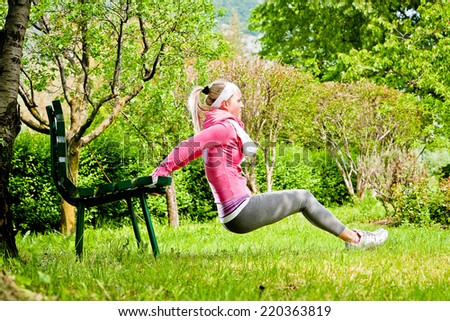 Woman exercising stretching in a Park - stock photo